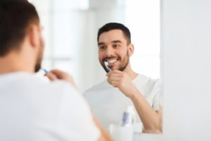 Man brushing teeth